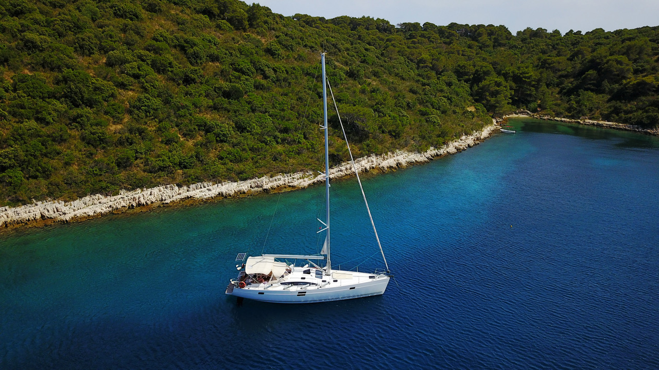 A SECLUDED BAY WITH ELAN IMPRESSION 494 WILD WIND - SAILING IN CROATIA